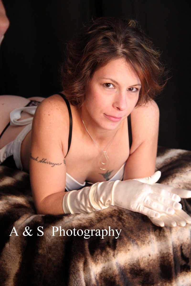 Boudoir sessions are tasteful portraits with a hint of sexiness. We